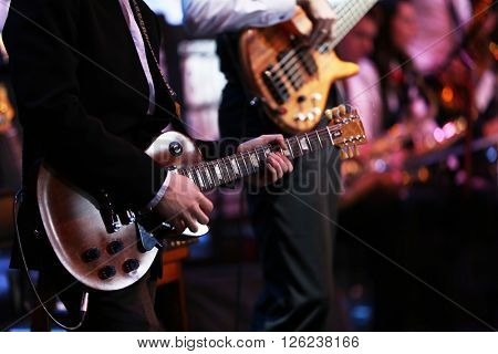 Guitarist playing the guitar at concert