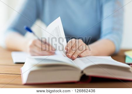 high school, education, people and learning concept - close up of young student or woman with book w