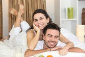Portrait of a smiling couple having breakfast
