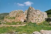 stock photo of nuragi  - anciet nuraghe at west coast of sardinia - JPG