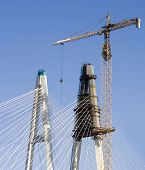 Construction industrial site - bridge assembling with huge crane and falsework