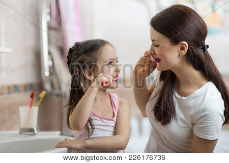 Little Kid Girl And Mom