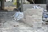 Cement Block Pile In The Construction Site For Built The Countryside House.many Bricks At Constructi poster