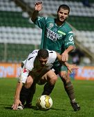 KAPOSVAR, HUNGARY - JULY 30: Pedro Sass (in green) in action at a Hungarian National Championship soccer game - Kaposvar (green) vs Videoton (white) on July 30, 2011 in Kaposvar, Hungary.