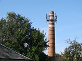 Постер, плакат: The Old Water Tower Is Used As A Cell Tower The Concept Of Converting One Into Another The Use Of