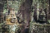 Bayon Temple Angkor Thom, The Serenity Of The Stone Faces Cambodia. Huge Sculptures Of Faces In The  poster