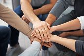 Young people putting hands together during group therapy, closeup poster