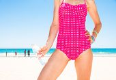 Blue Sea, White Sand Paradise. Closeup On Young Woman In Colorful Red Beachwear On The Seashore With poster
