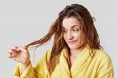 Adorable Female Looks At Split Ends After Taking Shower, Has Damaged Hair, Wears Domestic Clothes, I poster