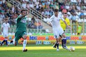 KAPOSVAR, HUNGARY - AUGUST 14: Zoltan Boor (in white 13) in action at a Hungarian National Champions
