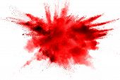 Abstract Red Dust Splattered On  White Background. Red Powder Explosion On White Background. Freeze  poster