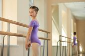Close Up Portrait Of Young Ballerina At Class. Beautiful Young Ballet-dancer In Purple Leotard. Ball poster