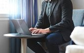 Business Man Working With Laptop In Hotel Room. Businessman Doing Remote Work With Computer. Person  poster
