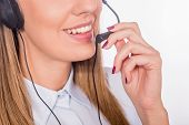 Beautiful Young Call-center Assistant Smiling, Woman Customer Service Worker, Call Center Smiling Op poster