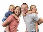 Young Happy And Beautiful American Family With Husband And Wife Carrying On Their Back Little Son An poster