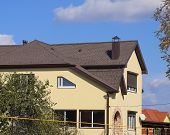 Decorative Metal Tile On A Roof. Types Of A Roof Of Roofs. Decorative Metal On The Roof Of The House poster