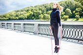 Woman Feet Jumping, Using Skipping Rope In Park. Beautiful Sports Girl Doing Cardio Exercises. poster