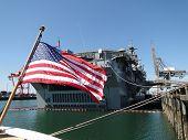 foto of amphibious  - American flag and Amphibious Assault Ship Bonhomme Richard LDH - JPG