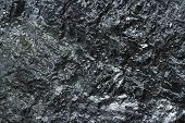 Close-up View Of Coal Mine. Raw Coal Mine Surface Close-up. Natural Black Coal Bar For Background. I poster