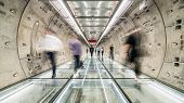 Motion Blur Of Unidentified Asian People Walking In Subway Tunnel Walkway. Underground Public Transp poster