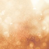 Christmas Glowing Golden Background. Christmas Lights. Gold Holiday New Year Abstract Glitter Defocu poster