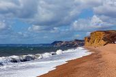 Freshwater Bay Beach And Waves Dorset View Towards Sandstone Cliffs, West Bay And Golden Cap poster