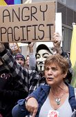 NEW YORK - MAY 1: A protester wearing a Guy Fawkes mask holds a sign that reads 'Angry Pacifist' dur