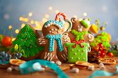 Christmas gingerbread cookies with Christmas decorations on wooden background. Traditional Christmas poster