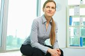 Smiling business woman sitting in office