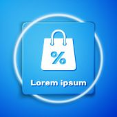 White Shoping Bag With An Inscription Percent Discount Icon Isolated On Blue Background. Handbag Sig poster