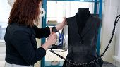 Sewing Products In Tailoring Business. Seamless Working Ironing Vest On Mannequin With Steam In Tail poster