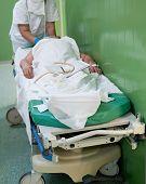 Nurse Prepares Patient For Operation