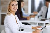 Business Woman Using Computer At Workplace In Modern Office. Secretary Or Female Lawyer Smiling And  poster