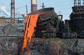 image of slag  - The molten steel is poured into the slag dump - JPG