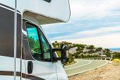 Modern Camper Van Rv Road Trip. Motorhome On The Scenic Vista Stop. Travel Industry. poster