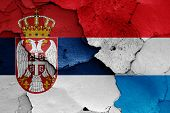 Flags Of Serbia And Luxembourg Painted On Cracked Wall poster