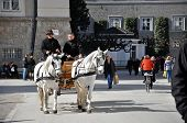 Horse driven carriage with tourists in Salzburg, Austria