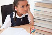 Bullying racism concept sad mixed race biracial African American schoolgirl or girl sitting at schoo poster