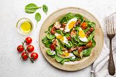 Salad With Spinach, Sun-dried Tomatoes And Eggs. Healthy Home Made Food. Concept For A Tasty And Hea poster