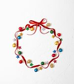 Christmas composition  with red ribbon and Christmas ornaments in shape of Christmas bauble on white poster