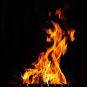 Fire Flame. Beautiful Bright Burning Fire At Night. A Fire In The Grill, Fireplace And Hearth. poster