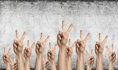 Row Of Man Hands Showing Victory Gesture. Winning Or Triumph Group Of Signs. Human Hands Gesturing O poster