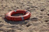 Lifebelt on sand