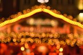 Illumination Of Christmas Market In Germany, Europe. Defocused Christmas Bokeh Lights Decoration poster