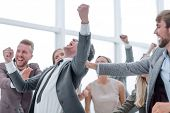 group of cheerful company employees congratulating their colleague poster