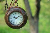 hanging round clocks outdoor
