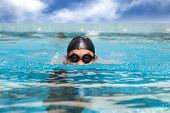foto of breast-stroke  - man in the Swimming pool with breast stroke - JPG