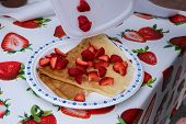 A Close Up View Of Freshly Prepared Pancakes On A Plate, Topped With Fresh Strawberries. Fresh Food  poster