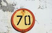 old road  sign ,speed limit 70 km