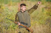 Man Brutal Unshaved Gamekeeper Nature Background. Hunting Permit. Hunter Hold Rifle. Hunting Is Brut poster